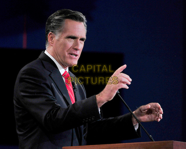 03 October 2012 - Denver, Colorado - Former Massachusetts Governor Mitt Romney, the Republican Party nominee for President, makes a point as he meets United States President Barack Obama, the Democratic Party nominee for President, during the first Presidential Debate of the 2012 General Election at the University of Denver. .half length red tie suit grey gray suit finger .CAP/ADM/CNP/RS.©Ron Sachs/CNP/ADM/Capital Pictures.