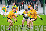 Finuge V Listowel: Finuge's Stephen Power wins the ball despite the close attention of Listowel's John Heaphy & Noel Kennelly in their County Division 2  clash in Finuge on Sunday last.