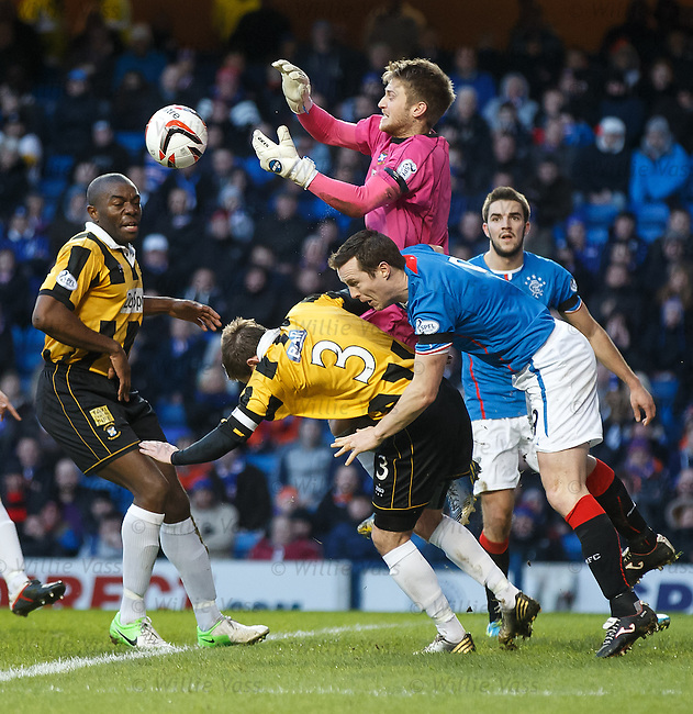 East Fife keeper Greg Paterson and defenders Joe Mbu and Craig Johnstone combine to deny Rangers striker Jon Daly