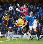 East Fife keeper Greg Paterson and defenders Joe Mbu and Craig Johnstone combine to deny Rangers striker Jon Daly