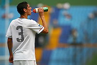 Valentin Zarek takes a drink. USA Men's Under 20 defeated Panama 2-0 at Estadio Mateo Flores in Guatemala City, Guatemala on April 2nd, 2011.