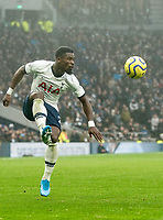 26th December 2019; Tottenham Hotspur Stadium, London, England; English Premier League Football, Tottenham Hotspur versus Brighton and Hove Albion; Serge Aurier of Tottenham Hotspur jumps to control the ball - Strictly Editorial Use Only. No use with unauthorized audio, video, data, fixture lists, club/league logos or 'live' services. Online in-match use limited to 120 images, no video emulation. No use in betting, games or single club/league/player publications