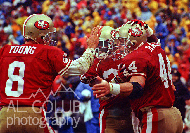 San Francisco 49ers vs. Miami Dolphins at Candlestick Park Sunday, December 6, 1992.  49ers Beat Dolphins 27-3.  San Francisco 49ers quarterback Steve Young (8) celebrates with running backs Dexter Carter (35) and Tom Rathman (44).