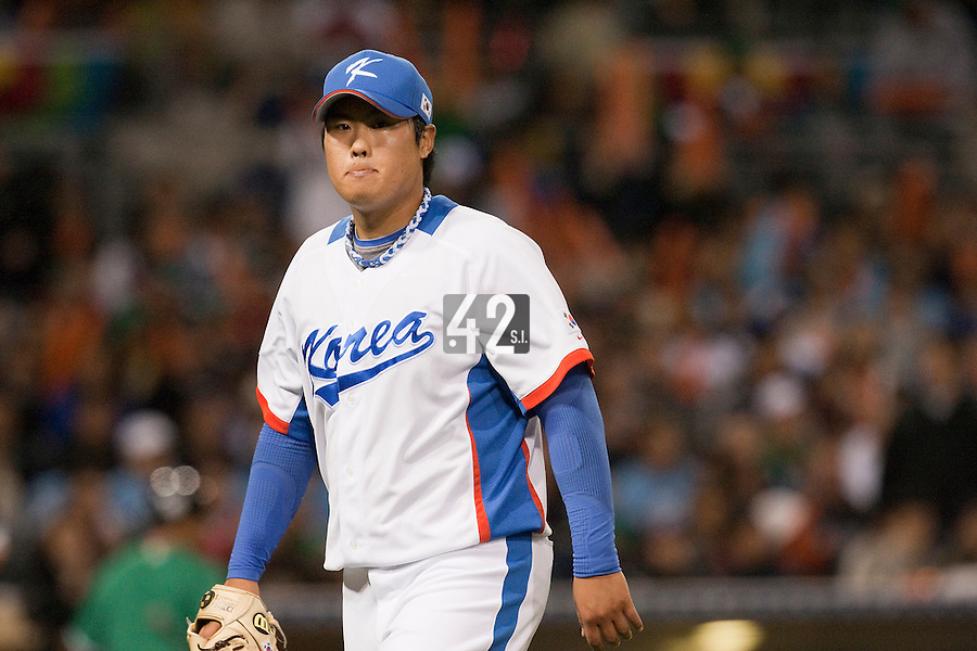 15 March 2009: #99 Hyun Jin Ryu of Korea walks back to the dugout during the 2009 World Baseball Classic Pool 1 game 2 at Petco Park in San Diego, California, USA. Korea wins 8-2 over Mexico.