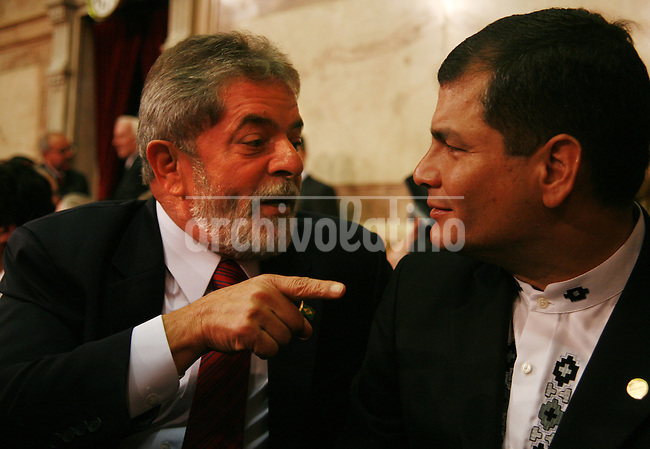 Brazil President Luiz Inacio Lula da Silva speaks with his counterpart from Ecuador, Rafael Correa, during the inauguration of new Argentina President