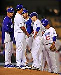22 July 2011: Los Angeles Dodgers Manager Don Mattingly (left) and his infield, congregate on the mound for a pitching change during play against the Washington Nationals at Dodger Stadium in Los Angeles, California. The Nationals defeated the Dodgers 7-2 in their first meeting of the 2011 season. Mandatory Credit: Ed Wolfstein Photo