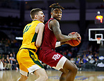 SIOUX FALLS, SD - MARCH 7: Ade Murkey #0 of the Denver Pioneers pivots and drives to the basket against Chris Quayle #13 of the North Dakota State Bison at the 2020 Summit League Basketball Championship in Sioux Falls, SD. (Photo by Richard Carlson/Inertia)