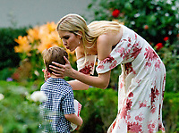 Assistant to the President Ivanka Trump kisses one of her sons in the Rose Garden at the annual Congressional Picnic on the South Lawn of the White House in Washington, DC on Thursday, June 22, 2017.<br /> Credit: Ron Sachs / CNP /MediaPunch