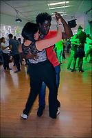 Casais dançando em baile popular, Galeria Olido, rua Dom Jose de Barros, Sao Paulo. 2018. Foto © Juca Martins.