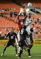 Troy Perkins #23 of D.C. United appears to los his head from a challenge by Alvaro Saborio #15  of Real Salt Lake during an Open Cup match at RFK Stadium, on June 2 2010 in Washington DC. DC United won 2-1.