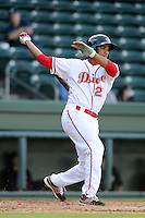 Shortstop Dreily Guerrero (26) of the Greenville Drive bats in a game against the Delmarva Shorebirds on Monday, April 29, 2013, at Fluor Field at the West End in Greenville, South Carolina. Delmarva won, 6-5 in game one of a doubleheader. (Tom Priddy/Four Seam Images)