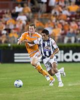 Pachuca FC midfielder Jaime Correa (6) and Houston Dynamo forward Nate Jaqua (27)chase the ball. Houston Dynamo defeated Pachuca FC 2-0 during the semifinals of the Superliga 2008 tournament at Robertson Stadium in Houston, TX on July 29, 2008.