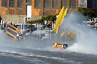 2004 Bay City River Roar, Bay City, Michigan, 26-27 June, 2004..Frame 5:.Chris Fairchild (L, #62) and Terry Rinker (R,#10) come together during the inverted start for Saturday's 2 heat race. Both boats suffer a blowover, Fairchild's boat landing upside down in the river only to be run over by Todd Bowden. During Rinkers crash, his boat snagged a pier with the lower unit, ripping it away. The boat continued skyward, hitting the staircase from the lower to the upper pier and then striking a piling with the right rear of the hull, with that large chunk falling to the pier below (to be seen in a later picture. Rinker continued his backflip, finally landing just a few feet from a docked pleasure boat filled with spectators. No one was injured in the accident and both drivers made the restart in their backup boats...©F. Peirce Williams 2004..F. Peirce Williams .photography.P.O. Box 455 Eaton, Ohio 45320 USA.p: 317.358.7326 e: fpwp@mac.com