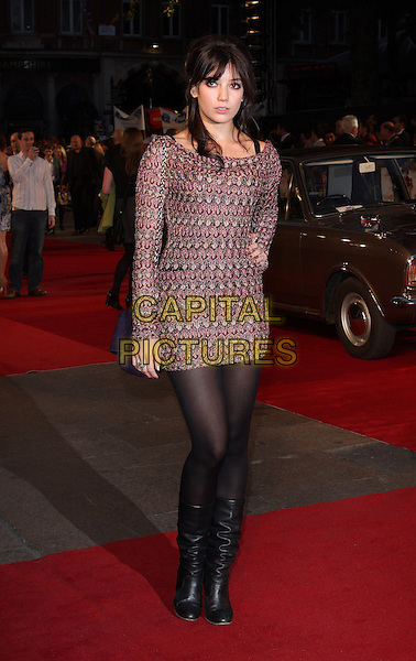 DAISY LOWE .World Premiere of 'Made In Dagenham' at the Odeon, Leicester Square, London, England, UK, September 20th 2010..full length dress pink purple knitted knit dress patterned pattern mini black tights hand on hip boots long sleeve.CAP/ROS.©Steve Ross/Capital Pictures