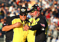 Jul. 26, 2013; Sonoma, CA, USA: NHRA official starter Mark Lyle (right) talks to a Safety Safari member during qualifying for the Sonoma Nationals at Sonoma Raceway. Mandatory Credit: Mark J. Rebilas-