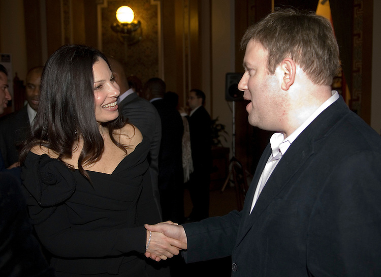 Actress Fran Drescher speaks with Republican pollster Frank Luntz during the 'Tribute to the 110th Congress' sponsored by the Creative Coaltion at B. Smith's restaurant in Washington on Wednesday night, Jan. 31, 2007.