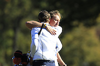 European Team Player Nicolas Colsaerts (BEL) with his caddy Brian Nilsson after conceding the match to USA's Dustin Johnson on the 16th green during Sunday's Singles Matches of the 39th Ryder Cup at Medinah Country Club, Chicago, Illinois 30th September 2012 (Photo Colum Watts/www.golffile.ie)