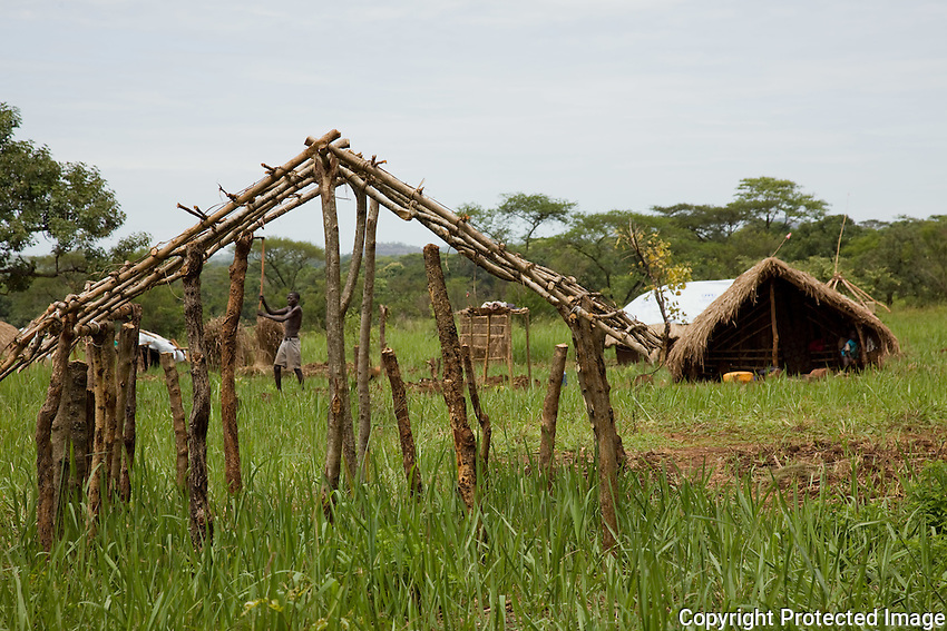 A man  tends to  his  crops in Nyori refugee camp in South Sudan.. The refugees fled  during the rainy season and are at risk  for food shortages. many  return to their home areas in Congo to gather  what food they can..