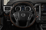 Car pictures of steering wheel view of a 2017 Nissan Titan Platinum-Reserve-Crew 4 Door Pickup Steering Wheel