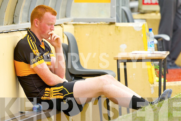 Johnny Buckley sits on the sidelines with an ice pack on his hamstring