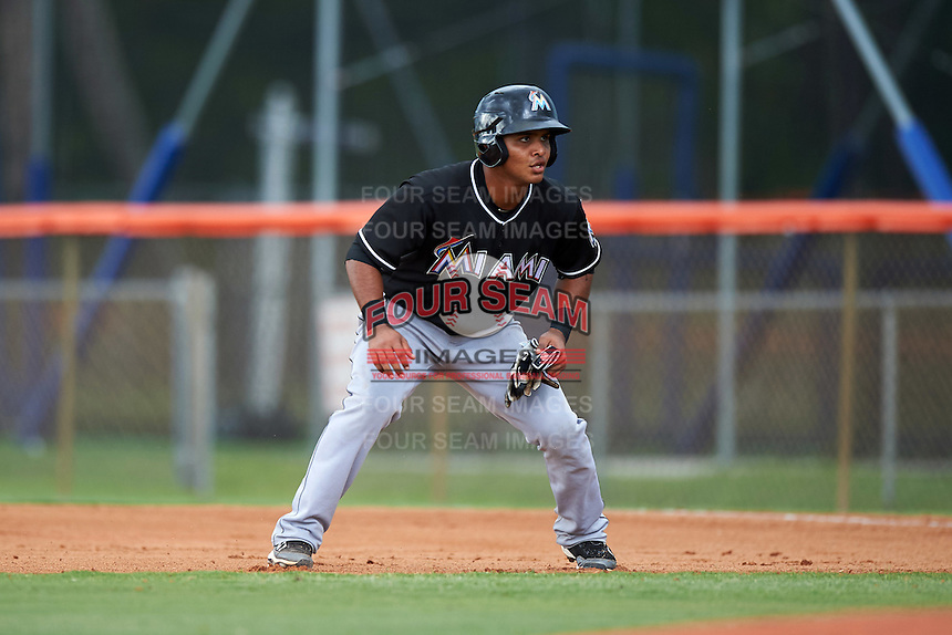 GCL Marlins designated hitter Angel Reyes (17) leads off first during the second game of a doubleheader against the GCL Mets on July 24, 2015 at the St. Lucie Sports Complex in St. Lucie, Florida.  The game was suspended in the first inning due to rain.  (Mike Janes/Four Seam Images)