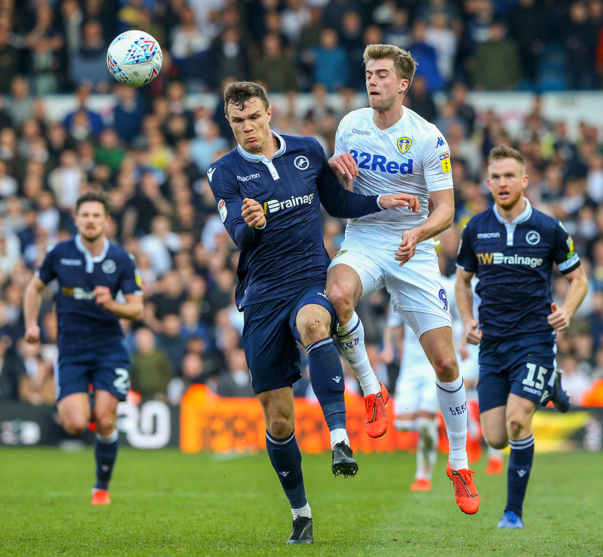 Leeds United's Patrick Bamford battles with Millwall's Jake Cooper<br /> <br /> Photographer Alex Dodd/CameraSport<br /> <br /> The EFL Sky Bet Championship - Leeds United v Millwall - Saturday 30th March 2019 - Elland Road - Leeds<br /> <br /> World Copyright © 2019 CameraSport. All rights reserved. 43 Linden Ave. Countesthorpe. Leicester. England. LE8 5PG - Tel: +44 (0) 116 277 4147 - admin@camerasport.com - www.camerasport.com