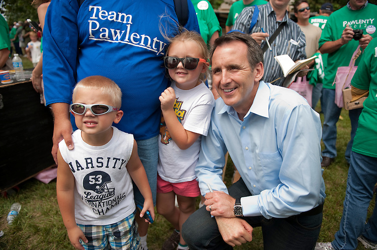UNITED STATES - AUGUST 13:  Gabrielle Kielkucki, 7, of Manchester, Iowa, and her brother Joseph, 5, poses with Republican presidential candidate Tim Pawlenty at Iowa State University, during the Ames Straw Poll in Ames, Iowa.  (Photo By Tom Williams/Roll Call)