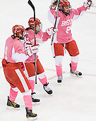 Jenn Wakefield (BU - 9), Jill Cardella (BU - 22) and Kayla Tutino (BU - 8) celebrate Cardella's goal. - The Boston University Terriers defeated the visiting Northeastern University Huskies 3-2 on Saturday, January 28, 2012, at Agganis Arena in Boston, Massachusetts.