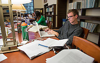 Occidental College student Kevin Siebs '14 studies for finals on Dec. 11, 2013 in the Ahmanson Reading Room of the Academic Commons. (Photo by Marc Campos, Occidental College Photographer)
