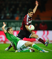 FUSSBALL   1. BUNDESLIGA    SAISON 2012/2013    17. Spieltag   SV Werder Bremen - 1. FC Nuernberg                     16.12.2012 Nils Petersen (li, SV Werder Bremen) gegen Per Nilsson (re, 1 FC Nuernberg)