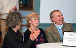 WOODBURY,  CT-122716JS10-- Martha Newell, center, Woodbury class of 1965,  and her friend Mark Alvarez, right, look on as a slideshow of Newell is being played prior to her introduction during the third annual Nonnewaug Athletic Club's Woodbury-Bethlehem Hall of Fame ceremony held Tuesday at the Old Town Hall in Woodbury. Being inducted this year were Karl Warner (1928), winner of the gold medal in the 4x1600 really in the 1932 Olympics; Martha Newell (1965), Richard Archambault (1966) and Kelly McOmber (2000). <br /> Jim Shannon Republican-American