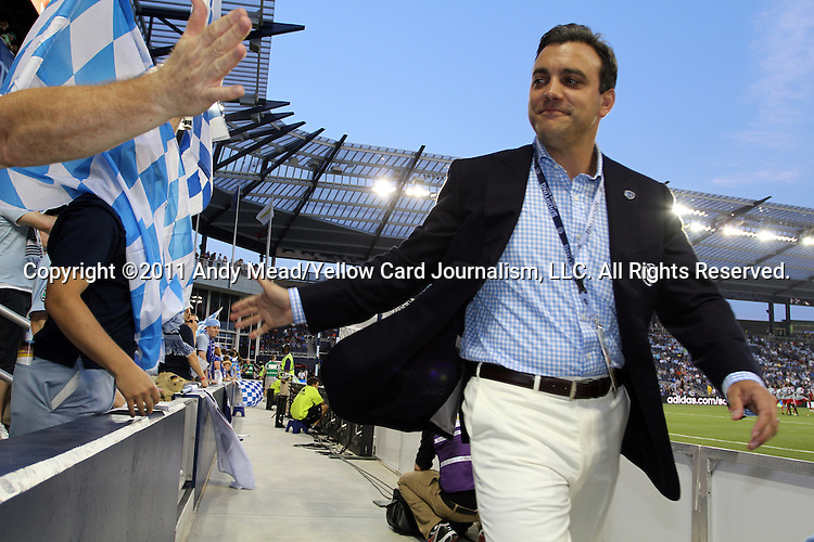 09 June 2011: Kansas City team president Robb Heineman (right) walks around the field before the game greeting fans. Sporting Kansas City played the Chicago Fire to a 0-0 tie in the inaugural game at LIVESTRONG Sporting Park in Kansas City, Kansas in a 2011 regular season Major League Soccer game.