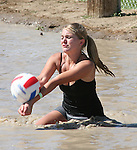 Blair Humphrey sets the ball during mud volleyball at the 2008 Cantaloupe  Festival.  Photo by Tom Smedes.