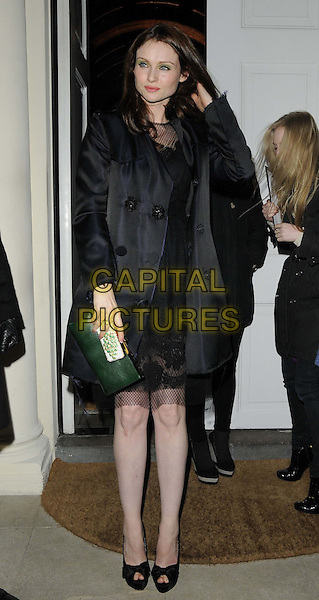 Sophie Ellis Bextor.attended the Diet Coke 30th birthday party, Sketch, Conduit St., London, England..January 30th, 2013.full length black dress coat netting chiffon hand arm green clutch bag peep toe shoes .CAP/CAN.©Can Nguyen/Capital Pictures.