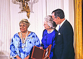 United States President George H.W. Bush and first lady Barbara Bush present the National Medal of Arts to American dancer and choreographer Katherine Dunham during a ceremony in the East Room of the White House in Washington, DC on November 19, 1989. <br /> Credit: Ron Sachs / CNP