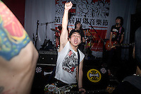 The Nanjing-based punk band Old Doll perform for a small crowd at Live Bar in Shanghai, China.
