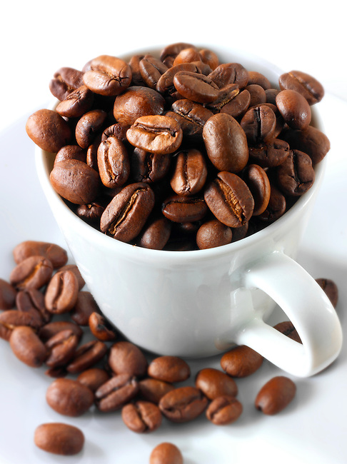 Coffee beans in a coffee cup. Stock Photo.