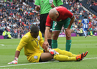Men's Olympic Football match Honduras v Morocco on 26.7.12...Noureddine Amrabat of Morocco apologises to Jose Mendoza of Honduras after fouling him, during the Honduras v Morocco Men's Olympic Football match at Hampden Park, Glasgow..........