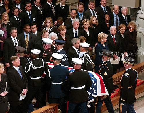 The casket containing the remains of former United States President Gerald R. Ford is carried by a military honor guard out of the Washington National Cathedral, in Washington, D.C. on Tuesday, January 2, 2006. In the front row are: President George W. Bush,first lady Laura Bush,Vice President Dick Cheney, Lynne Cheney,former President Jimmy Carter, former first lady Roslyn Carter, and former first lady Nancy Reagan.  In the second row are former President George H.W. Bush, former first lady Barbara Bush, Doro Bush Koch, former President Bill Clinton, former first lady Senator Hillary Rodham Clinton (Democrat of New York), Chelsea Clinton, Secretary of State Condoleezza Rice, Secretary of the Treasury Henry M. Paulson, Jr., and Secretary of Defense William Gates.  Jack Ford and Susan Ford Bales look on from far left.<br /> Credit: Ron Sachs / CNP<br /> [NOTE: No New York Metro or other Newspapers within a 75 mile radius of New York City]