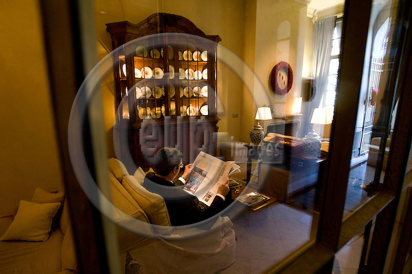 BRUSSELS - BELGIUM - 21 DECEMBER 2007 -- A man with a newspaper seen through windows in Salon 3 in the lobby at Hotel Le Dixseptième seen from Rue de la Madeleine.  Photo: Erik Luntang/EUP-IMAGES/