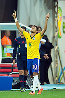 Neymar of Brazil celebrates scoring a goal after making it 1-1