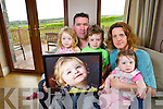 The Clifford Family with a photo of Cillian who passed away last month Chloe 3, Ted,  Connor 6, Fiona and Bella 1