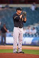 Fresno Grizzles pitcher Asher Wojciechowski (29) gets ready to deliver a pitch during a game against the Oklahoma City Dodgers on June 1, 2015 at Chickasaw Bricktown Ballpark in Oklahoma City, Oklahoma.  Fresno defeated Oklahoma City 14-1.  (Mike Janes/Four Seam Images)