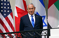 "Prime Minister Benjamin Netanyhu of Israel looks on as United States President Donald J. Trump and First lady Melania Trump host a signing ceremony of the ""Abraham Accords"" on the South Lawn of the White House in Washington, DC on Tuesday, September 15, 2020.  The Trumps are joined by Prime Minister Benjamin Netanyahu of Israel; Sheikh Abdullah bin Zayed bin Sultan Al Nahyan, Minister of Foreign Affairs and International Cooperation of the United Arab Emirates; and Dr. Abdullatif bin Rashid Alzayani, Minister of Foreign Affairs, Kingdom of Bahrain.<br /> Credit: Chris Kleponis / Pool via CNP /MediaPunch"