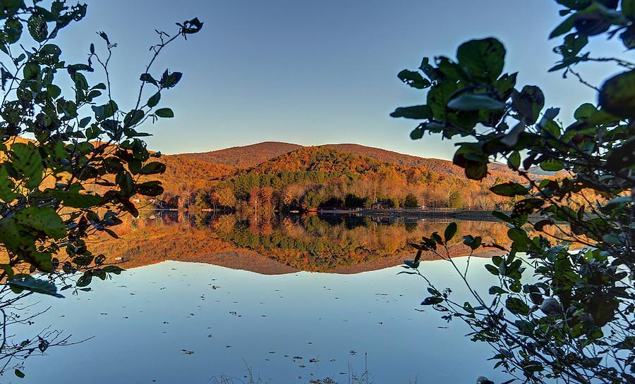 Sunrise at secret morning mountain lake reflecting the Blue Ridge Mountains in Greene County, Va. Photo/Andrew Shurtleff