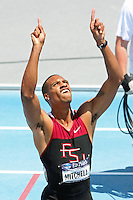 Maurice Mitchell points to the sky after capturing the 2011 NCAA Division I Outdoor Track and Field National Championship in the 200 meters at Drake Stadium in Des Moines Iowa.