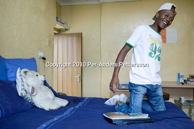 SOWETO,SOUTH AFRICA - JANUARY15: Thami Nkosi, a 29-year old activist, sits on his bed in his roomonJanuary15, 2010,in Soweto, South Africa. Thami is a gender justice activist and often counsels men how to use condoms and not to cheat or abuse women. He is part of the new young generation of black South African's who has got better education opportunities.Soweto is the largest township in South Africa, located about 10 kilometers southwest of downtown Johannesburg. The population is estimated to be around 2-3 million.(Photo by Per-Anders Pettersson/Getty Images)
