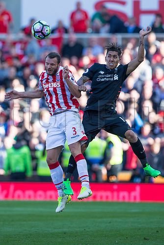April 8th 2017, bet365 Stadium, Stoke on Trent, Staffordshire, England; EPL Premier League football, Stoke City versus Liverpool; Stoke City's Erik Pieters and Liverpool's Roberto Firmino jump for the ball