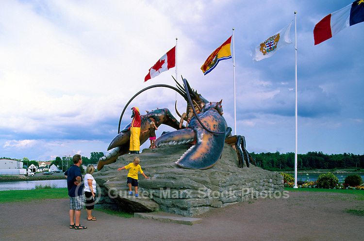 Shediac, NB, New Brunswick, Canada - Children climbing on World's Largest Lobster Sculpture, a Tourist Attraction