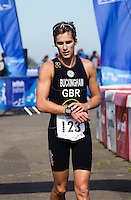 25 MAR 2012 - LOUGHBOROUGH, GBR - Mark Buckingham (Holmfirth Harriers) recovers after winning the men's 2012 British Elite Duathlon Championships at Prestwold Hall Airfield in Prestwold near Loughborough, Great Britain (PHOTO (C) 2012 NIGEL FARROW)